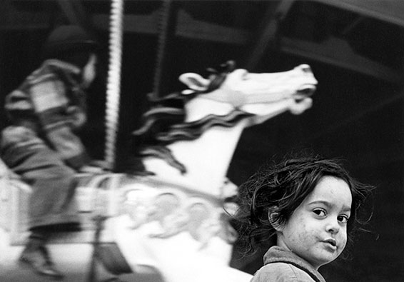 Harold Feinstein, Gypsy girl with Carousel, Coney Island, NY