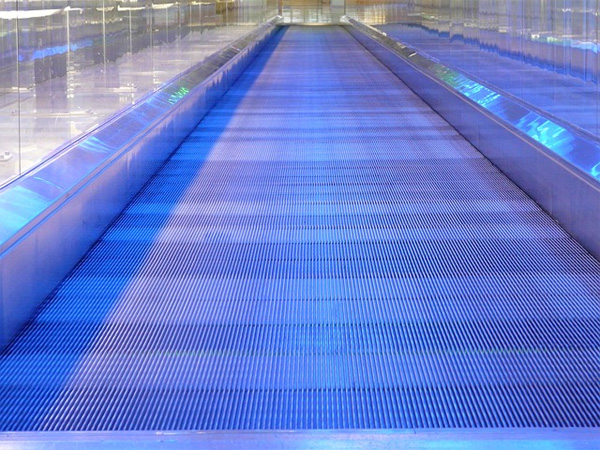 'Metal Segments Moving Walkway Roller Platform'. Image courtesy Public Domain Pictures.