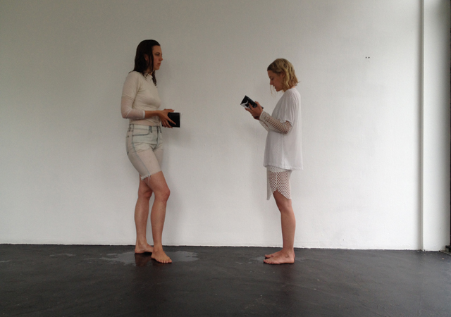 Performance/reading of a gesture waves us on, answering our own wave (2014) by V4ULT with Susan Ploetz and Julia Zange @ Center, Berlin. Courtesy the gallery.