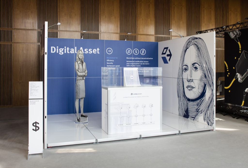Simon Denny with Linda Kantchev, 'Blockchain Visionaries' (2016) @ 9th Berlin Biennale for Contemporary. Installation view. Photo by Timo Ohler. Courtesy the artist + Galerie Buchholz, Cologne/Berlin/New York.